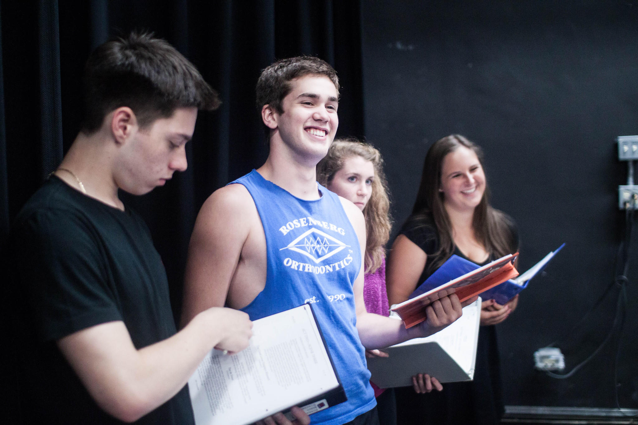 "Ryan DeFranzo, Thomas Doelger, Brigid Lucey and Kendall Edwards take a break while rehearsing a scene from ""On the Town."""