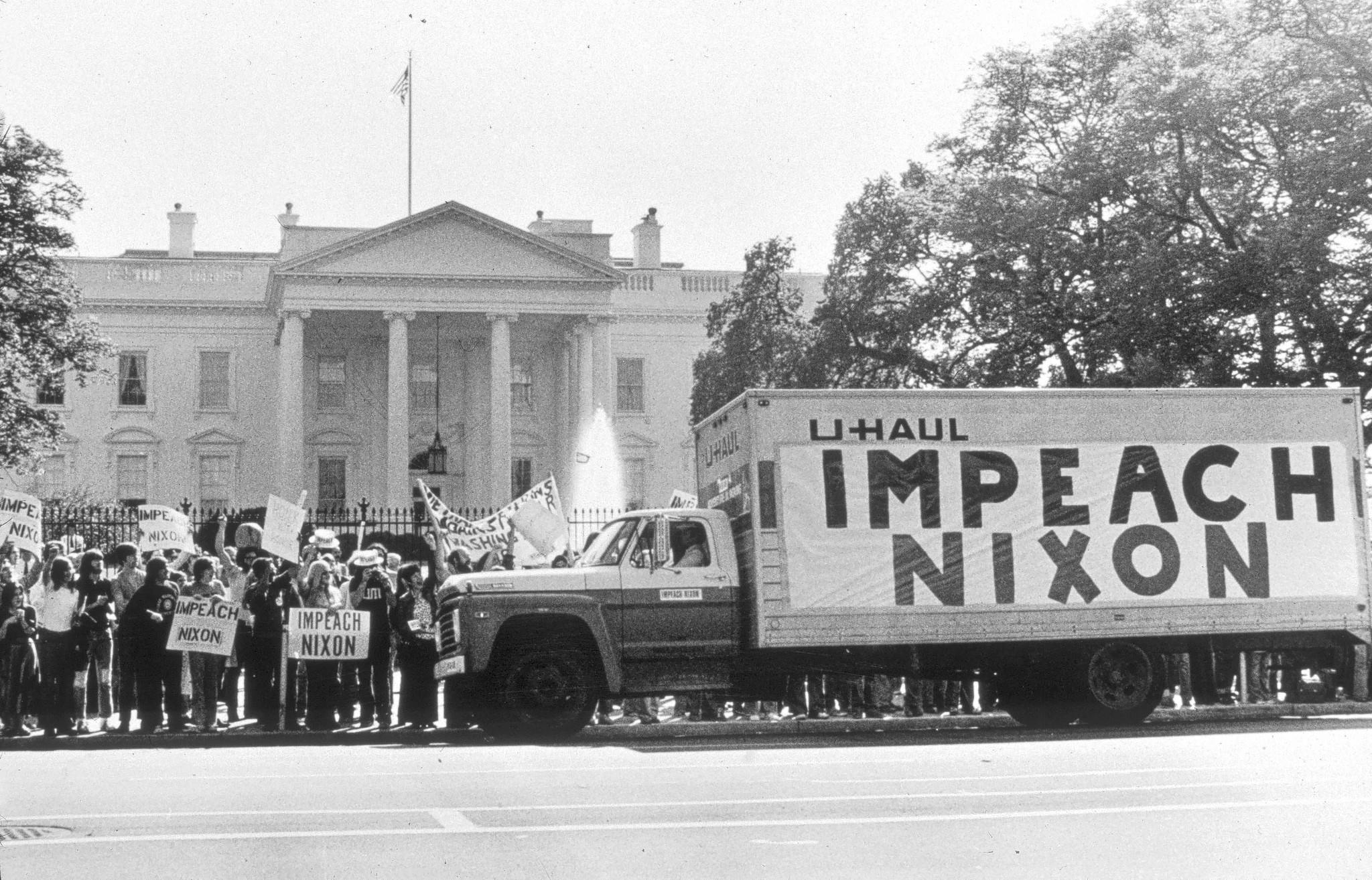 A demonstration gathers outside the White House in 1974 to support the impeachment of President Richard Nixon, who eventually resigned.