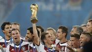 Germany damages its World Cup trophy during team celebrations