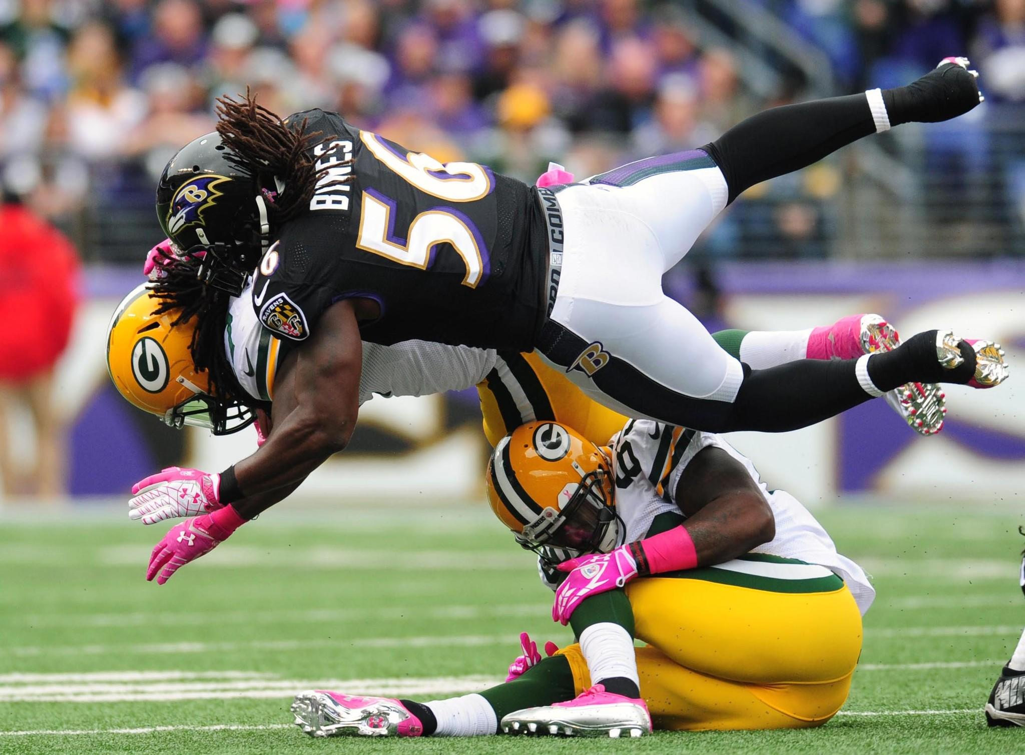 Ravens linebacker Josh Bynes tackles Green Bay Packers running back Eddie Lacy at M&T Bank Stadium.