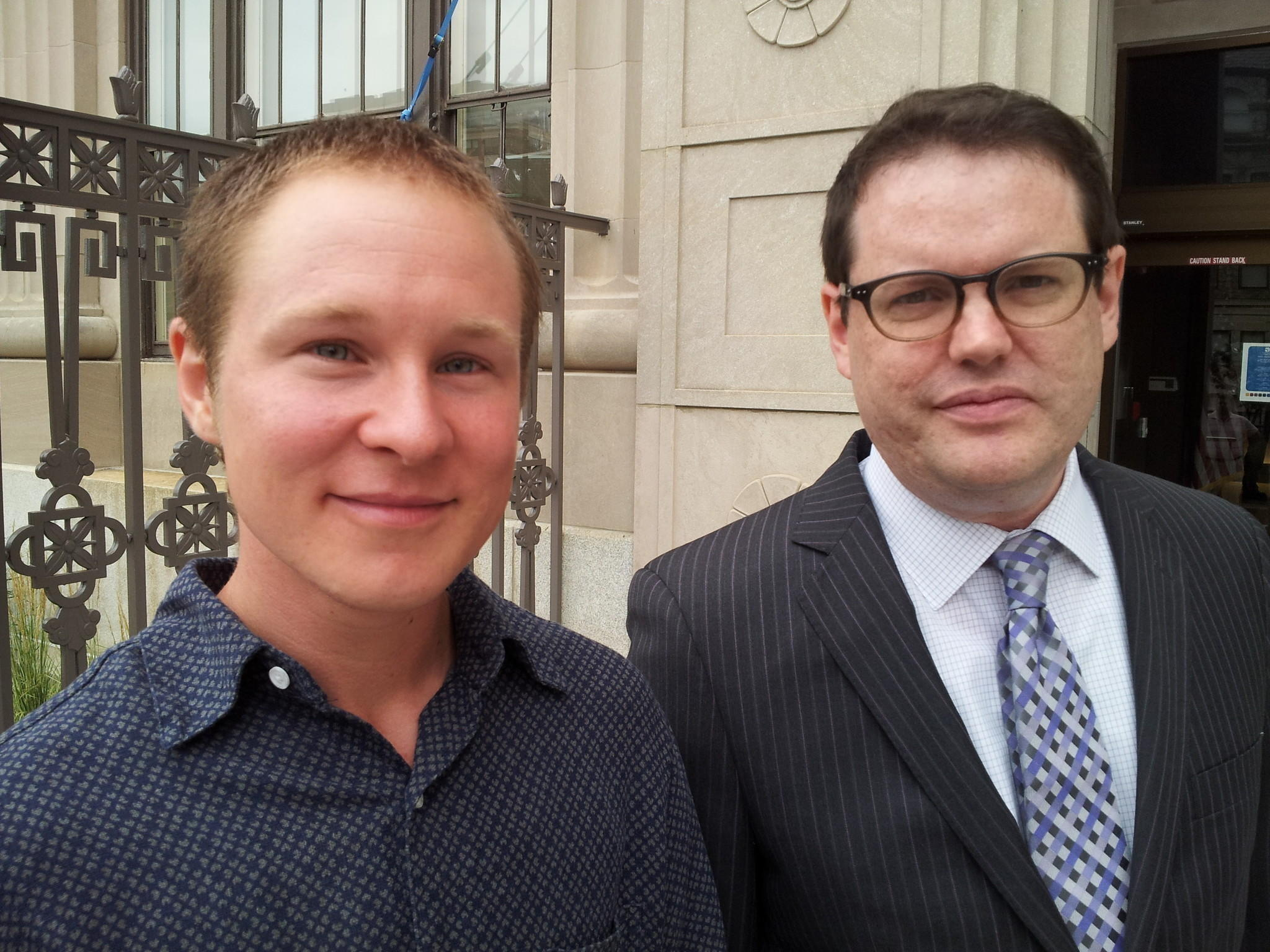 After Sailor Holobaugh, left, and his attorney Jer Welter, right, with Free State Legal, filed a discrimination claim against the state for denying health insurance coverage of Holobaugh's transition-related care, the state reversed its policy -- and now provides such care for all state employees and their dependents.