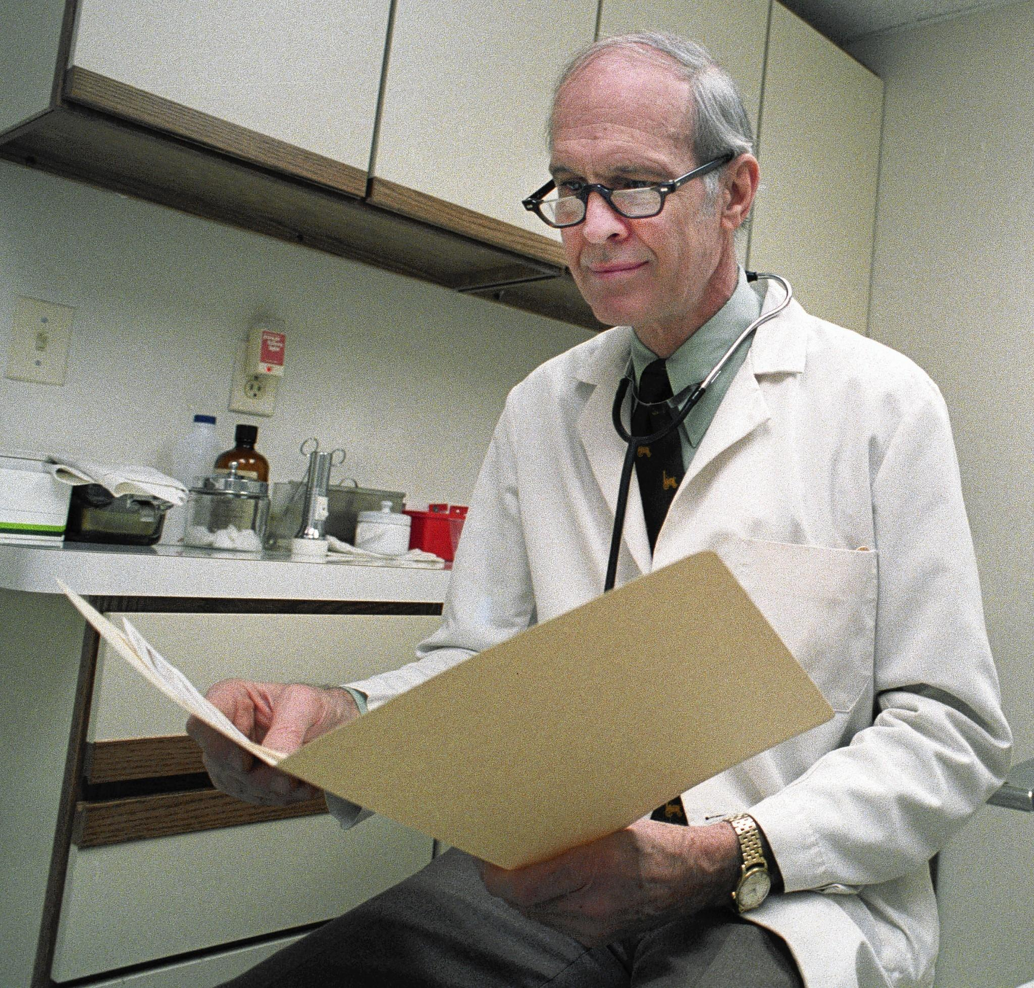 Dr. Thomas Herbert in his office in 1988.