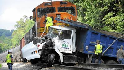 Train collides with dump truck in Mount Airy; no injuries