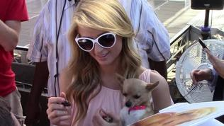 Paris Hilton greets her fans after taping The Extra Tv show