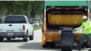 Move over for garbage trucks, utility vehicles