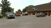 Video: Armed duo rob Aurora auto shop, demand jewelry