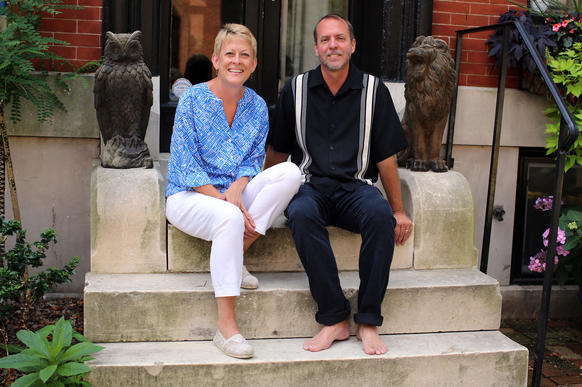 Kathy and Tim Nelson sit on their stoop outside of their 1875 home on E Baltimore St in Butcher Hill.