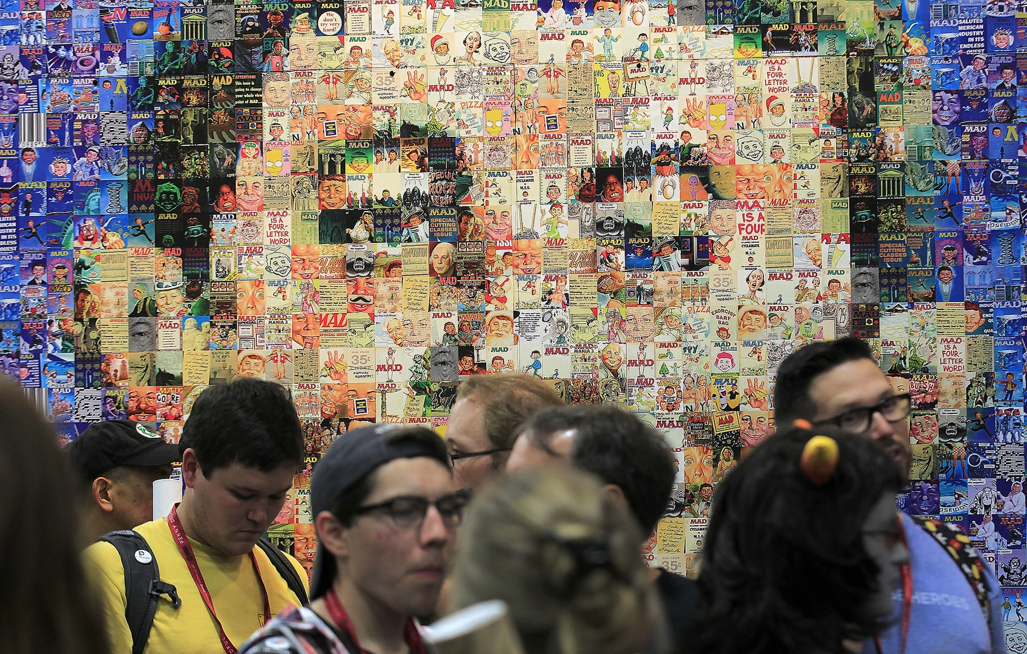 The face of fictitious mascot and cover boy Alfred E. Neuman shines through in a compilation of MAD magazine covers. (Brian van der Brug / Los Angeles Times)