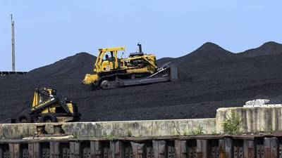 Koch brothers' petcoke firm threatens lawsuit over city rules
