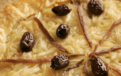 Onion tart with anchovies and olives