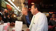 Christie brings $2.5 million for Rauner, springs for hot dogs