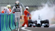 F1's Hamilton OK after car catches fire