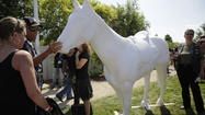Public art display of horse statues to honor fallen officers