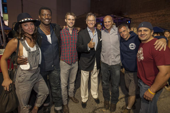 """Chicago Fire"" stars Stella Maeve (left), Eamonn Walker (second to left), Jesse Spencer (third to left), Randy Flagler (third to right), David Eigenberg (second to right) and Tony Ferraris (right) at 100 Club of Chicago's Pig Out for Charity at 25 Degrees July 23, 2014 with 100 Club's Joe Ahern (center)."