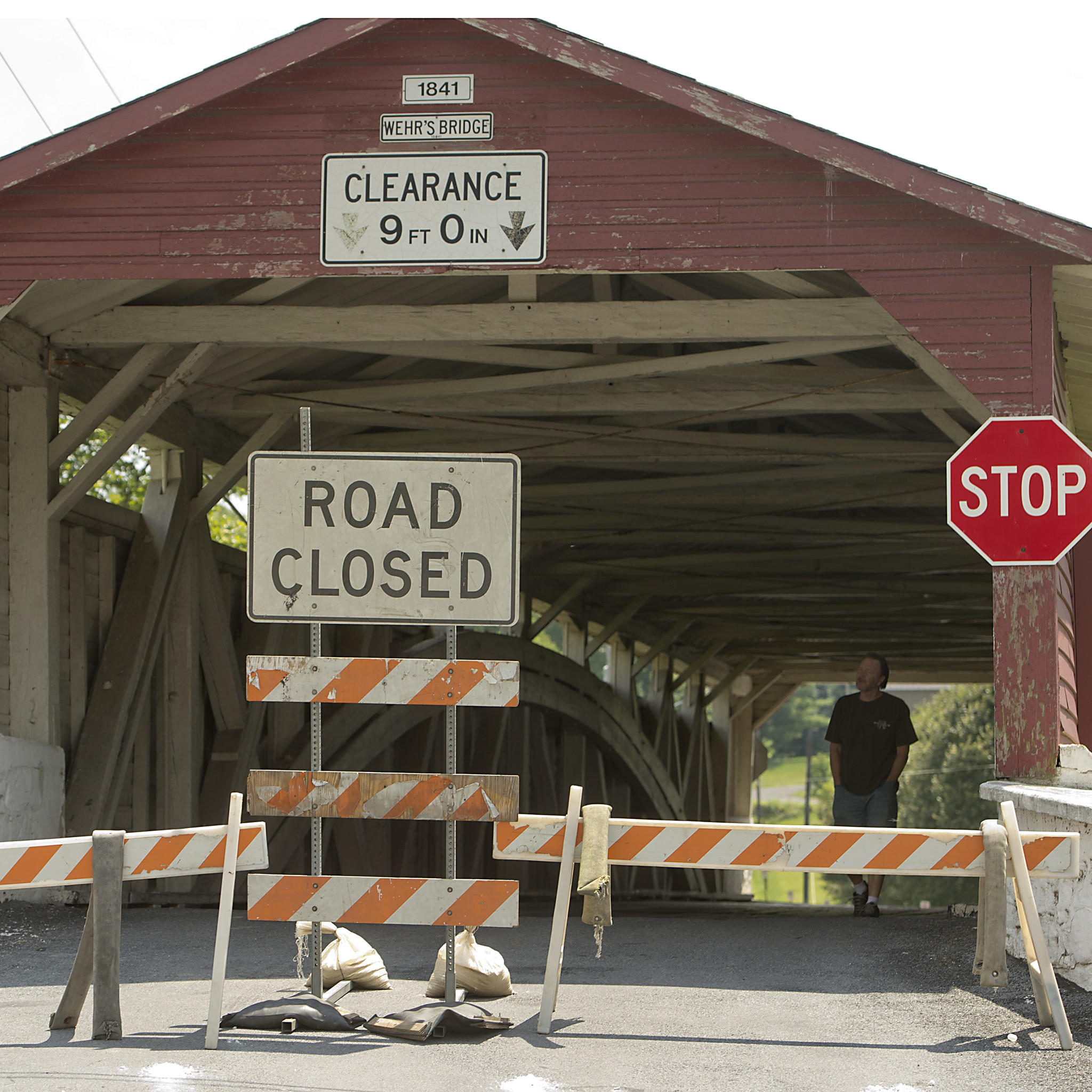 A plaque is posted on the Wehr's Covered Bridge on Wehr Mill Road in South Whitehall Township is pictured as the bridge is closed on Sunday, July 27, 2014, after an overweight truck crossed it Friday, police said. /// Harry Fisher / The Morning Call mc-South-Whitehall-Wehr-Mill-bridge-closed