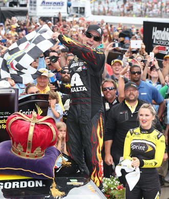 Jul 27, 2014; Speedway, IN, USA; NASCAR Sprint Cup driver Jeff Gordon (24) celebrates winning the Crown Royal Brickyard 400 at Indianapolis Motor Speedway.