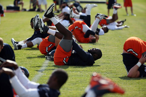 Bears players practice their backward somersaults. (Probably.) No pulled muscles here.