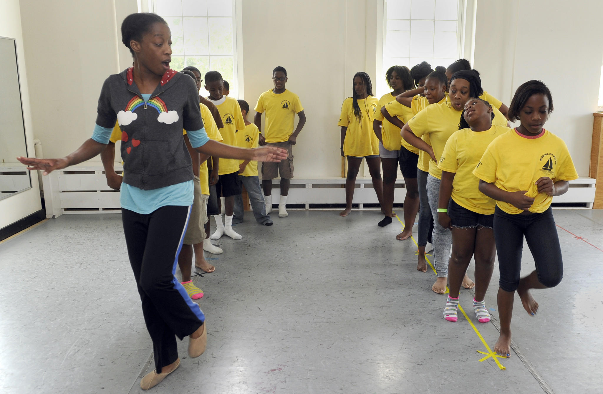 Children take a dance class at Maryland Hall as part of Artreach and the We Care and Friends program. The dance instructor is Kamaria Boyd, a visiting teacher from Dance Baltimore. Here, she leads them in a dance step.