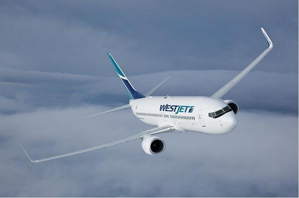 A WestJet aircraft in flight.