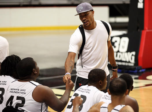 Derrick Rose greets players before a Noah's Arc Foundation One City basketball tournament organized by Joakim Noah at the United Center. The players in the tournament were 18-24 years old and are from South and West Side neighborhoods of Chicago.