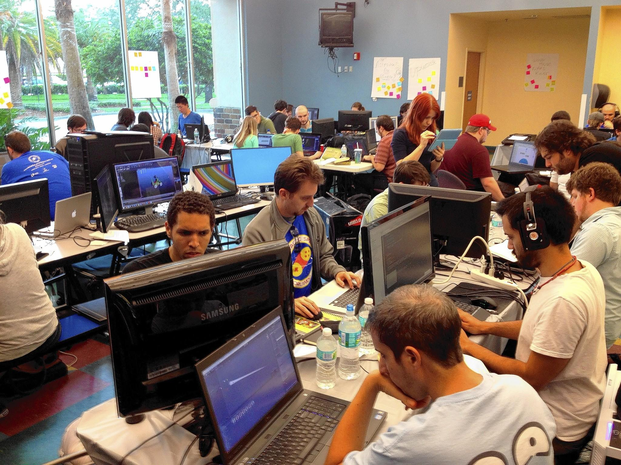 Teams work on developing space travel video games at IndieGalactic Space Jam.