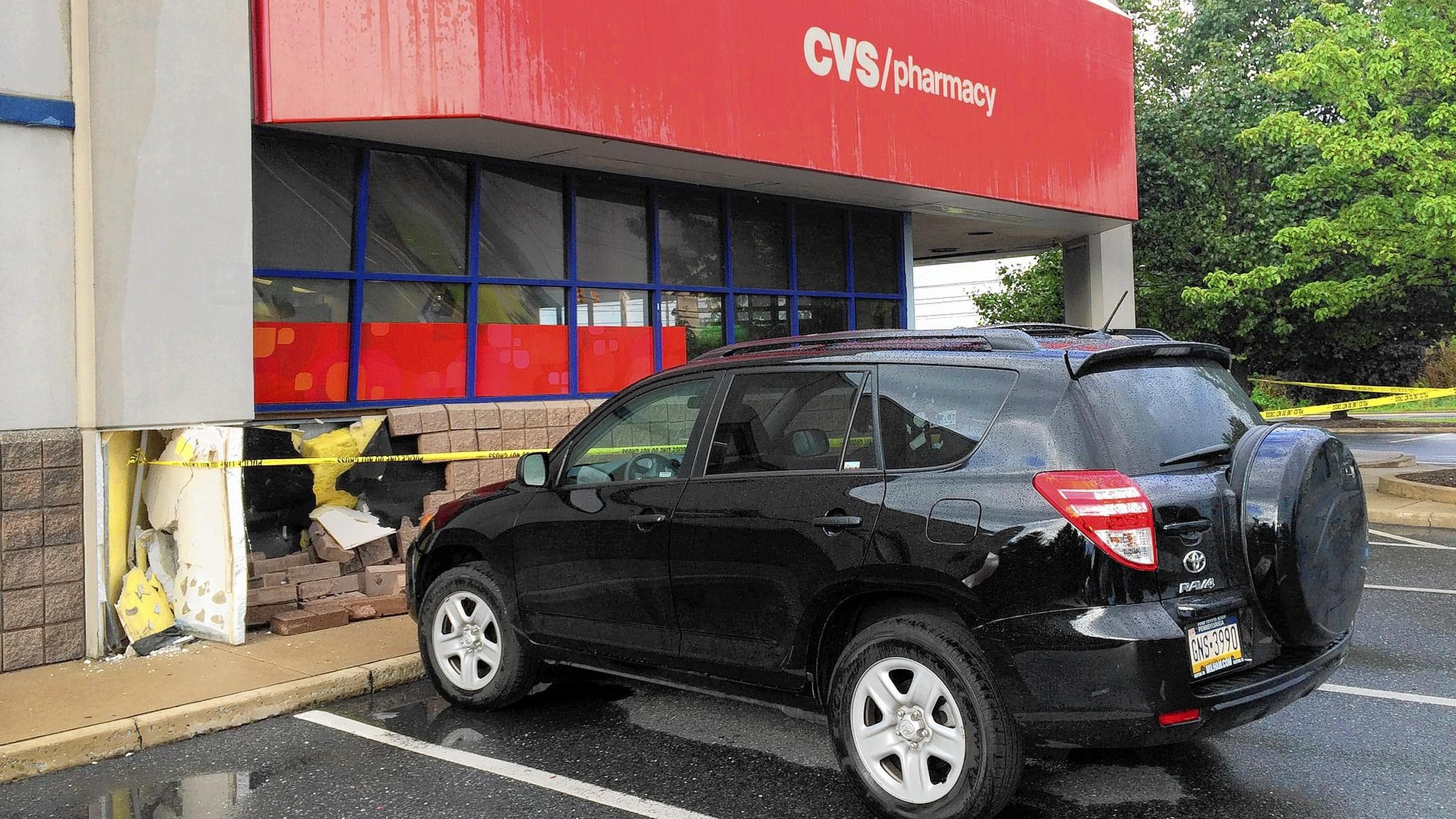 A section of wall is broken open at the CVS Pharmacy on Airport Road, Hanover Township, Northampton County, after a car crashed into the store Monday afternoon, knocking a shelf into two workers inside. The workers were treated for minor injuries.