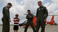 Highland Park boy reunites with crew that rescued him