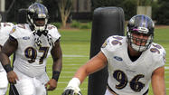 Ravens rookie Brent Urban injured right knee, Timmy Jernigan limps into training room