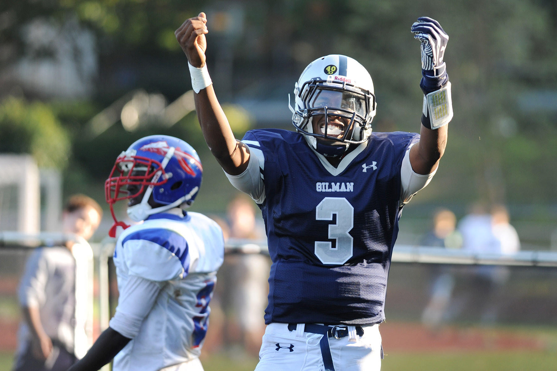 Gilman quarterback Kai Locksley celebrates a long run for a touchdown against Anacostia in September.