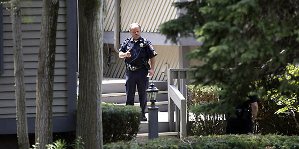 Tower Lakes police officers arrive at the home of the suspect in the shooting of an executive in a Loop office building. (Stacey Wescott, Chicago Tribune)