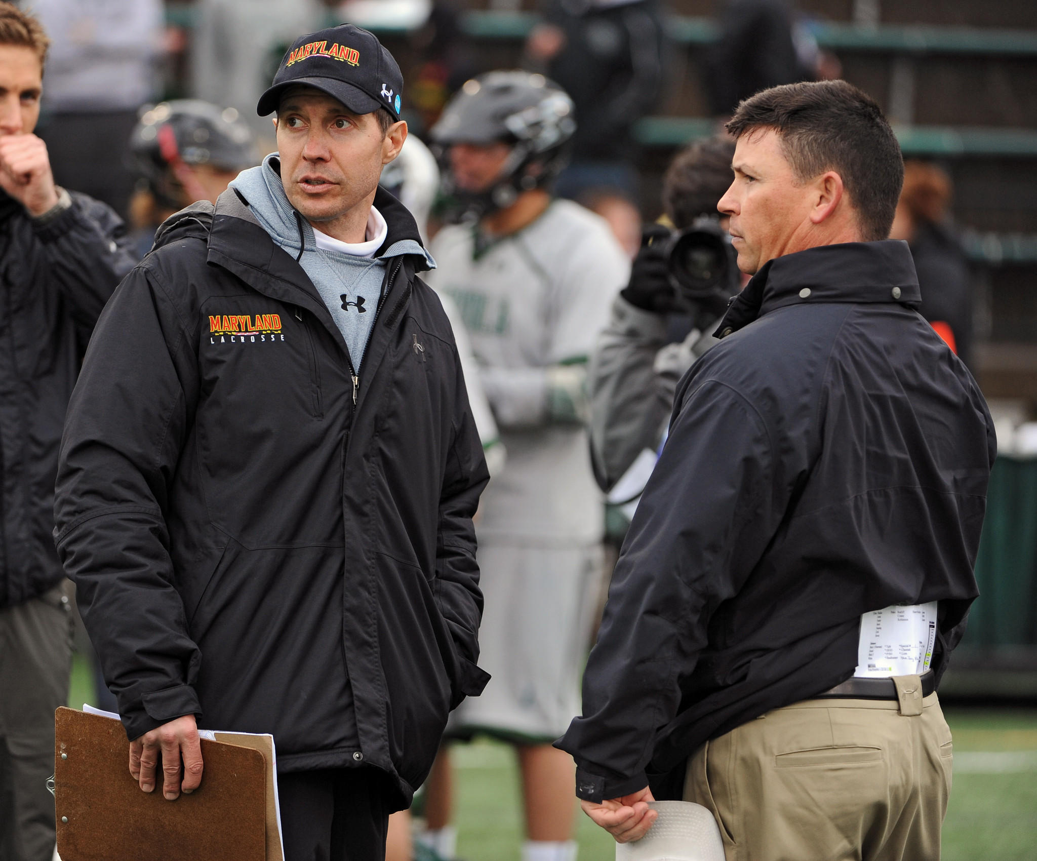 Maryland coach John Tillman, left, talks with Loyola coach Charley Toomey after their 2013 game. The Terps won, 12-10, in a rematch of the previous spring's title game.