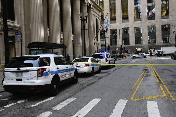 Chicago police units respond to the scene of a shooting at the Bank of America building in downtown Chicago. A man, who allegedly had been demoted in his job, allegedly shot the CEO of his company and then killed himself in the Bank of America building on S. LaSalle Street.