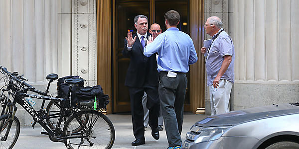 Police superintendent Garry McCarthy walks from 231 S. LaSalle St., where an executive killed himself after critically wounding the CEO of the firm on Thursday. (Nancy Stone/Tribune)