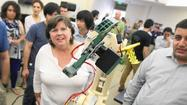 Students engineer success with 3-D printer and robotic arm