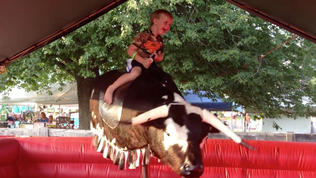 Riding the mechanical bull at Harford's farm fair [Video]