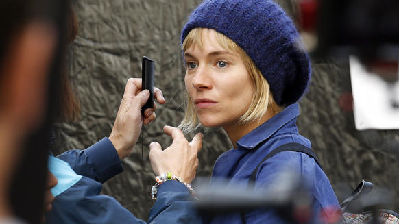 "Sienna Miller on the set of ""Adam Jones"" in London's Leicester Square."