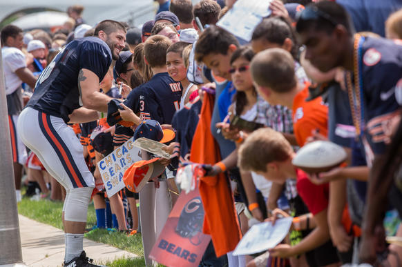 Tight end Zach Miller signs autographs after practice.