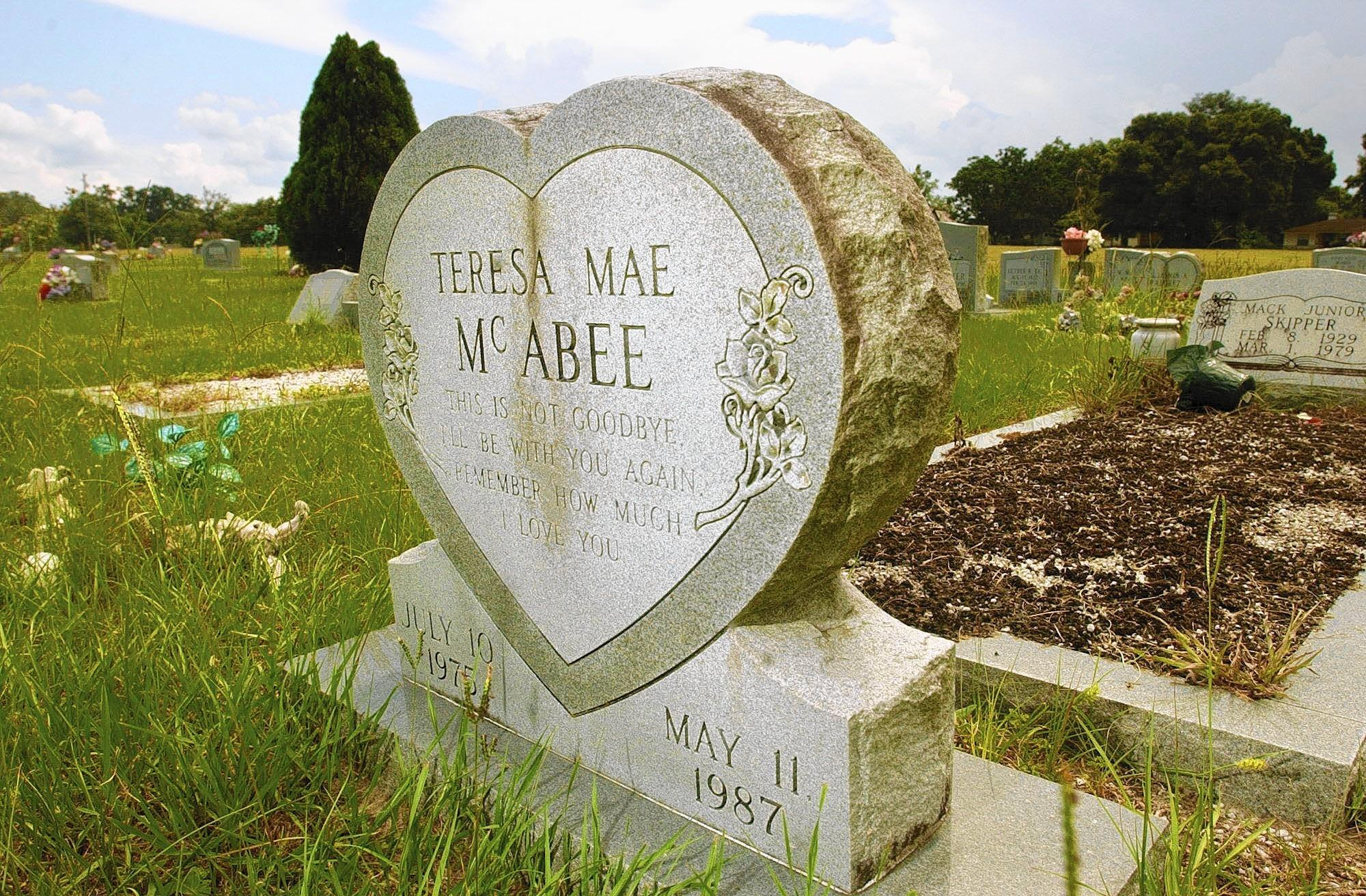 A heart-shaped stone with roses marks the grave of Teresa Mae McAbee at the Center Hill Cemetery on Thursday, July 10, 2003. Teresa was 11 years old when she was murdered in 1987.