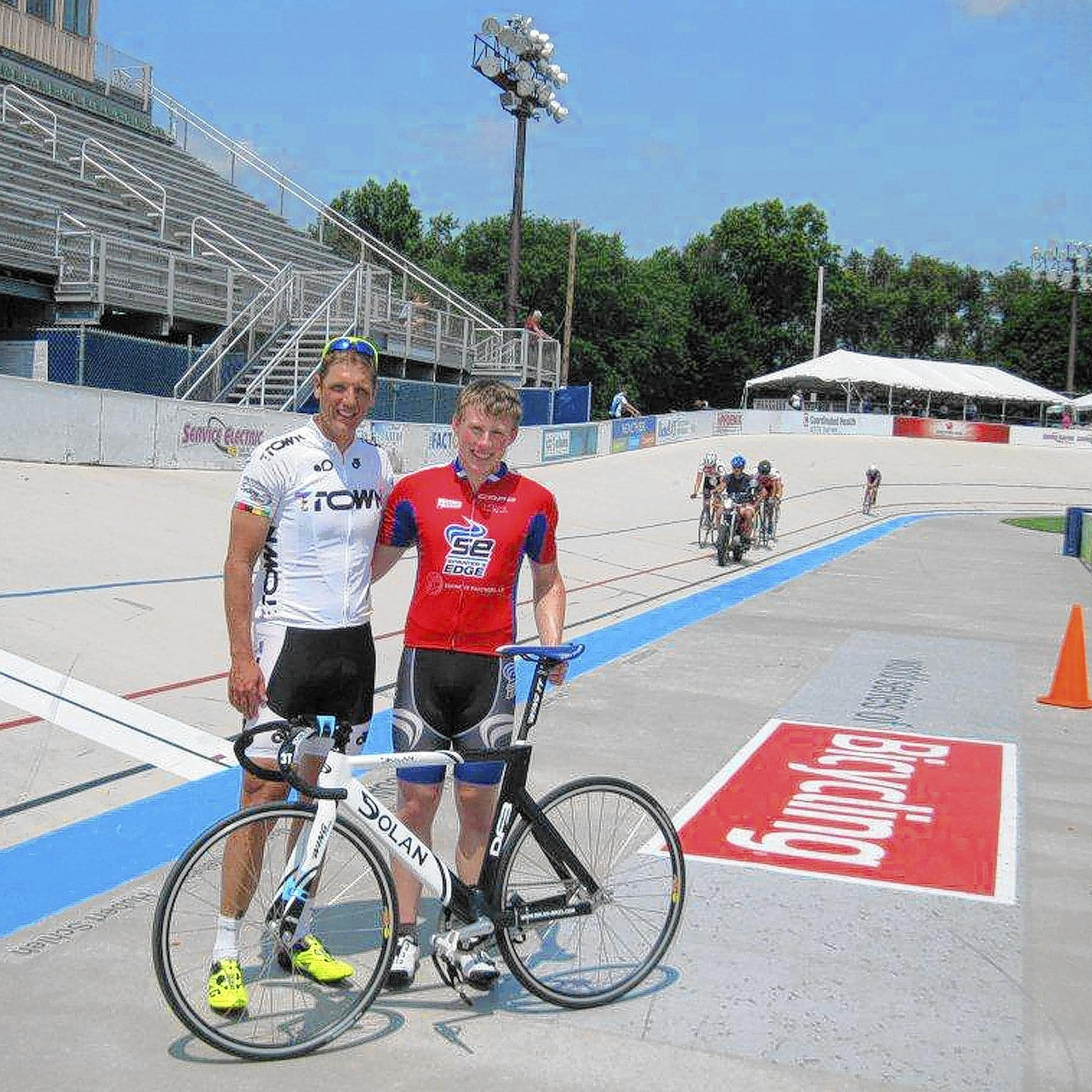 Marty Nothstein (left) joins cyclist James Mellen of Schnecksville during a practice session at the velodrome in Trexlertown.