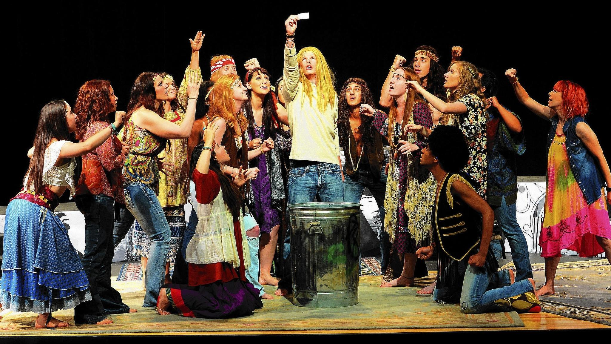 Dustin Brinker of Allentown (center) and Taylor Fernandez (top right) strike a pose during a rehearsal for 'Hair' at Cedar Crest College.