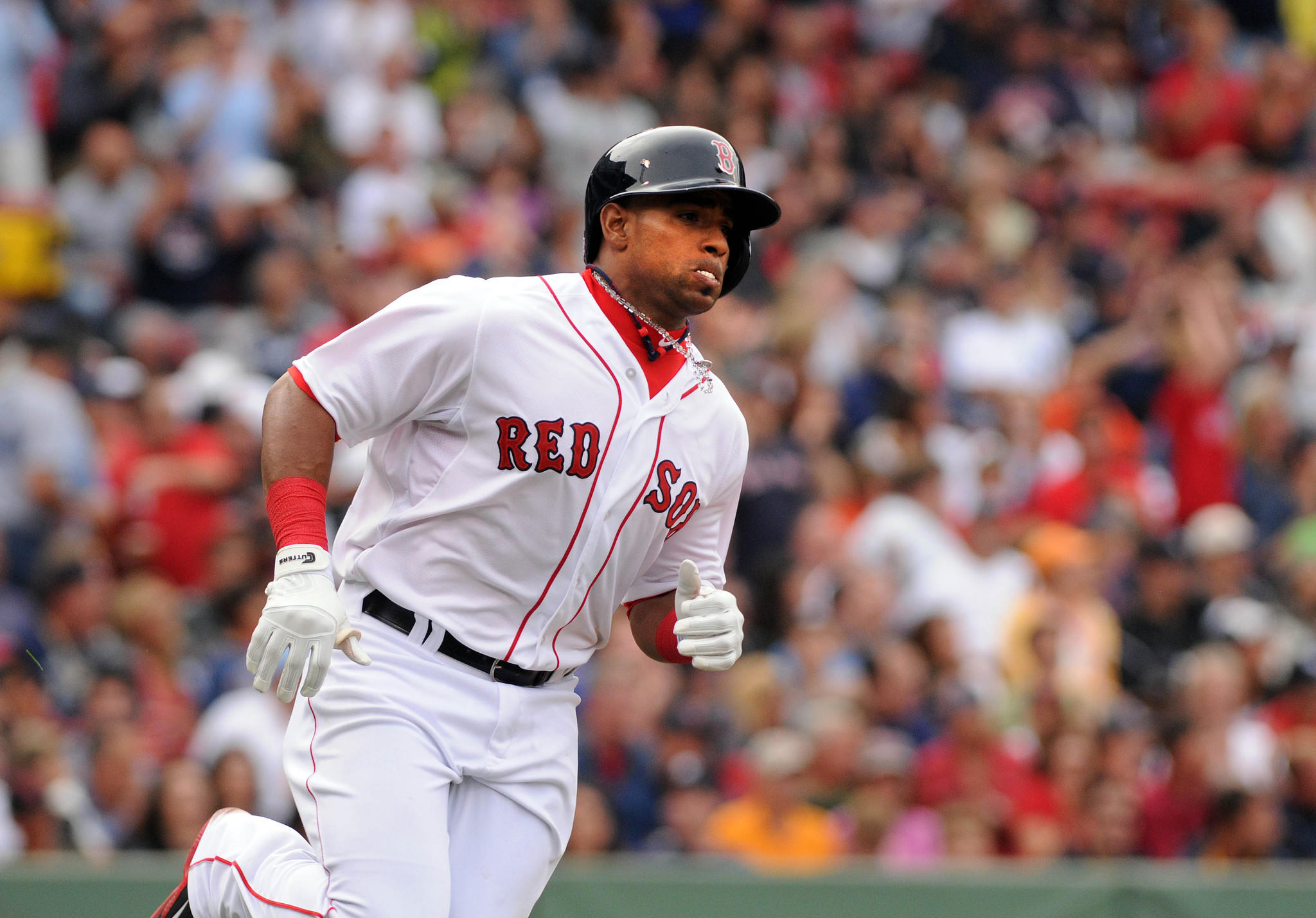 Yoenis Cespedes of the Red Sox runs to first base after getting a hit in the second inning Saturday against the Yankees at Fenway Park.