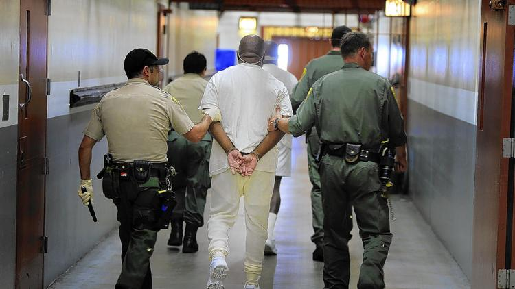 Two inmates are walked from their cells to the medical unit at Pelican Bay State Prison in Crescent City. (Mark Boster / Los Angeles Times)