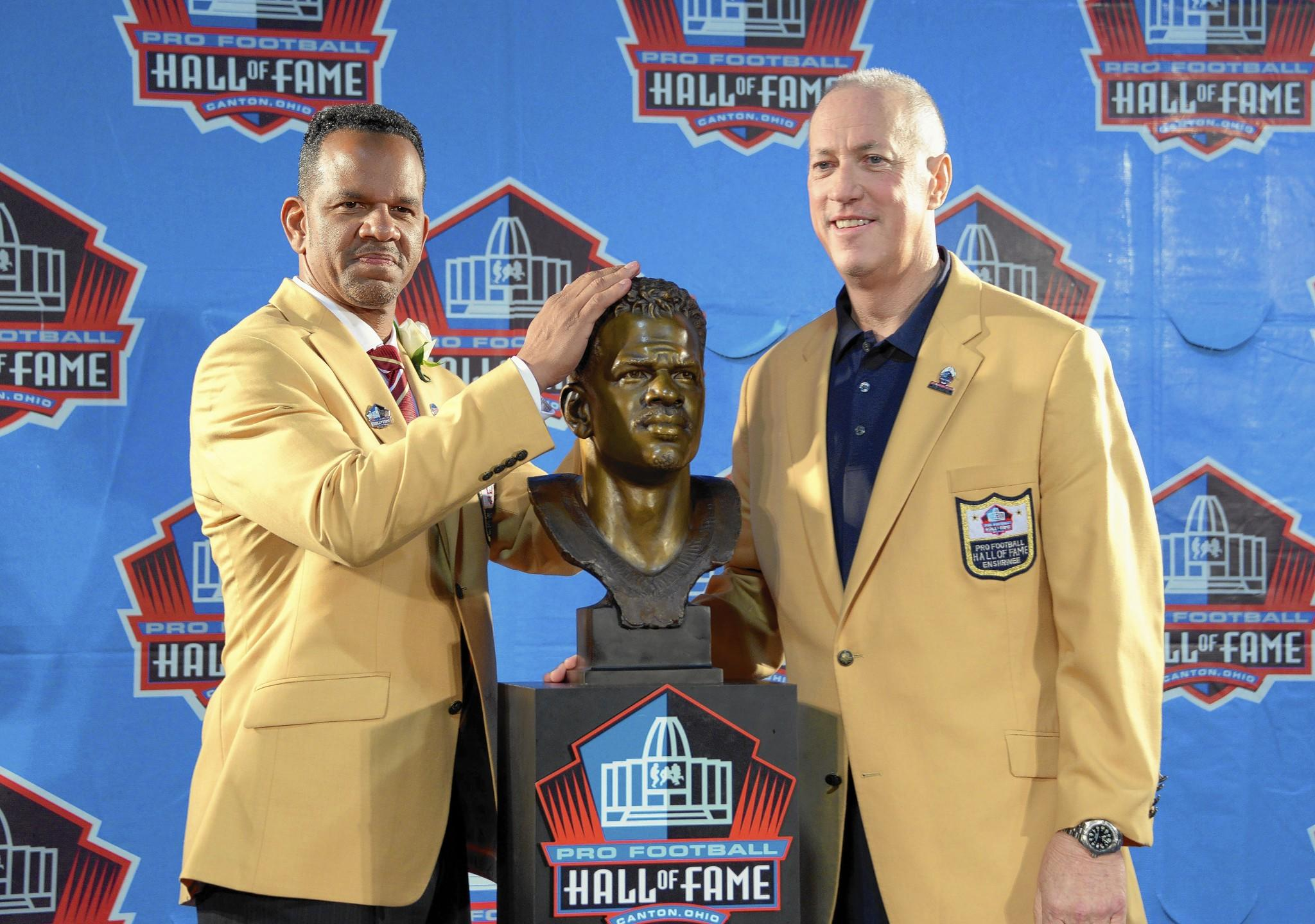 Allentown's Andre Reed (left) made special mention of his former quarterback, Jim Kelly. Reed called Kelly 'the toughest individual I've ever met in my life.'