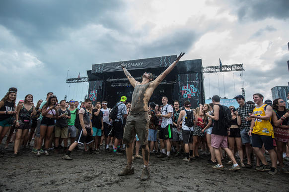 While waiting for Cage the Elephant to perform, attendees played in the mud. Rain and foot traffic caused many sections of Grant Park to become a slough at Lollapalooza on Aug. 3, 2014.