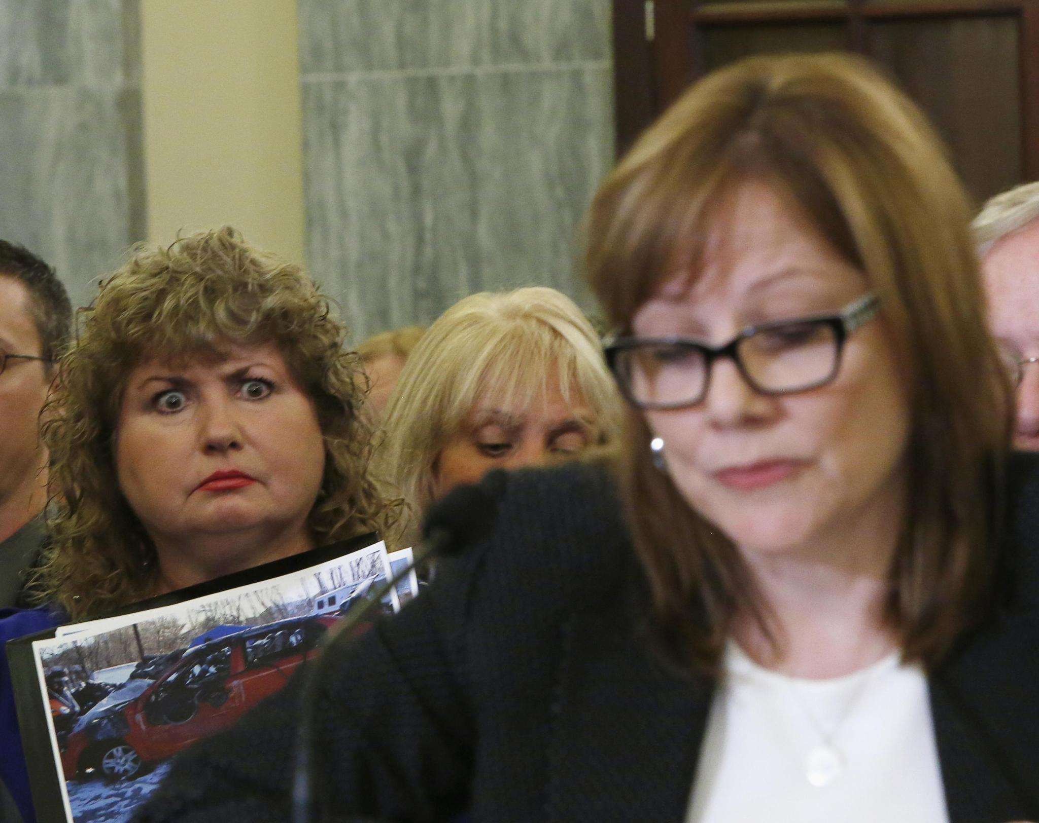 Mary Theresa Ruddy, whose daughter was killed in 2010 when she lost control of her 2005 Chevrolet Cobalt, holds a picture of the vehicle as GM CEO Mary Barra testifies before a Senate subcommittee on April 2.