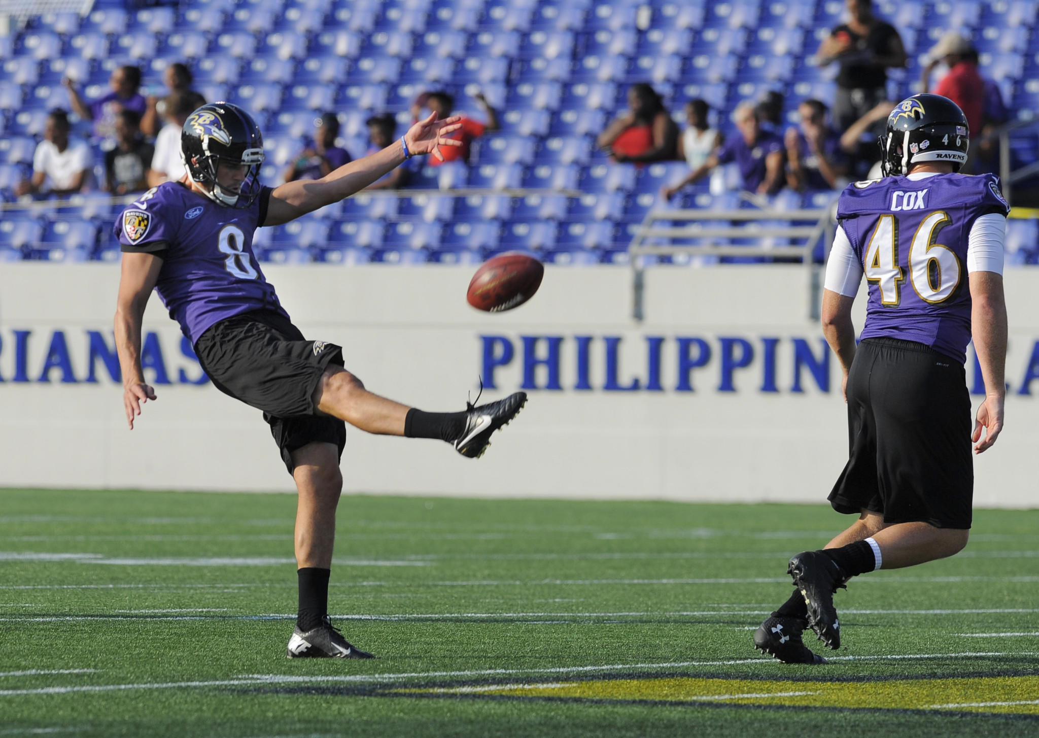 Ravens punter Richie Leone punts at practice during the open practice at Navy-Marine Corps Memorial Stadium on Monday.