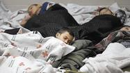 U.S. to close three interim shelters housing migrant children: reports