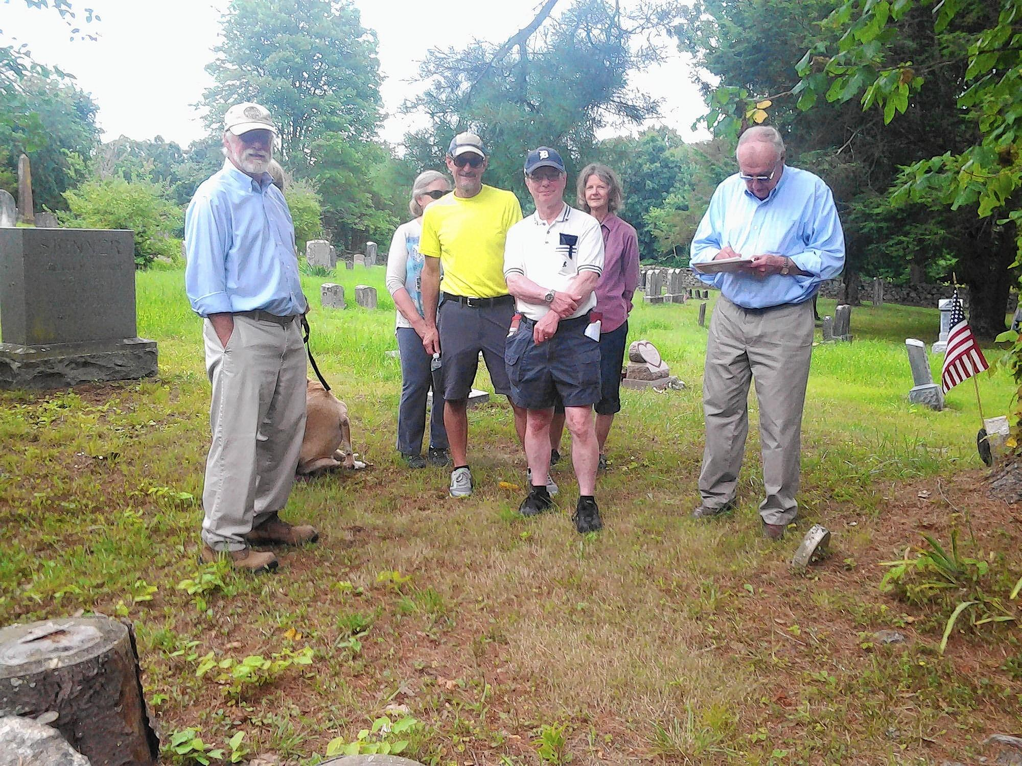 (L-r) John Barnowski, Stan Soby, Gary Walter and Ralph Adkins shared interest in the ancient burial grounds of descendents of settlers. The first grave is dated circa 1815, according to Nicholas Norton, who owns the land. Photo by Merja H. Lehtinen.