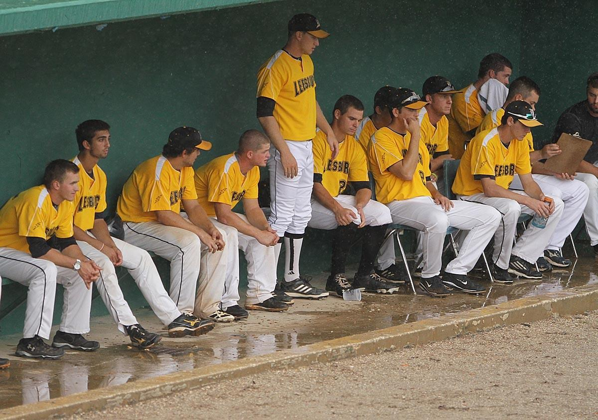 The Leesburg Lightning wait in their dugout during a rain delay at a Florida Collegiate Summer League game vs. the Orlando Monarchs at Tinker Field in Orlando.