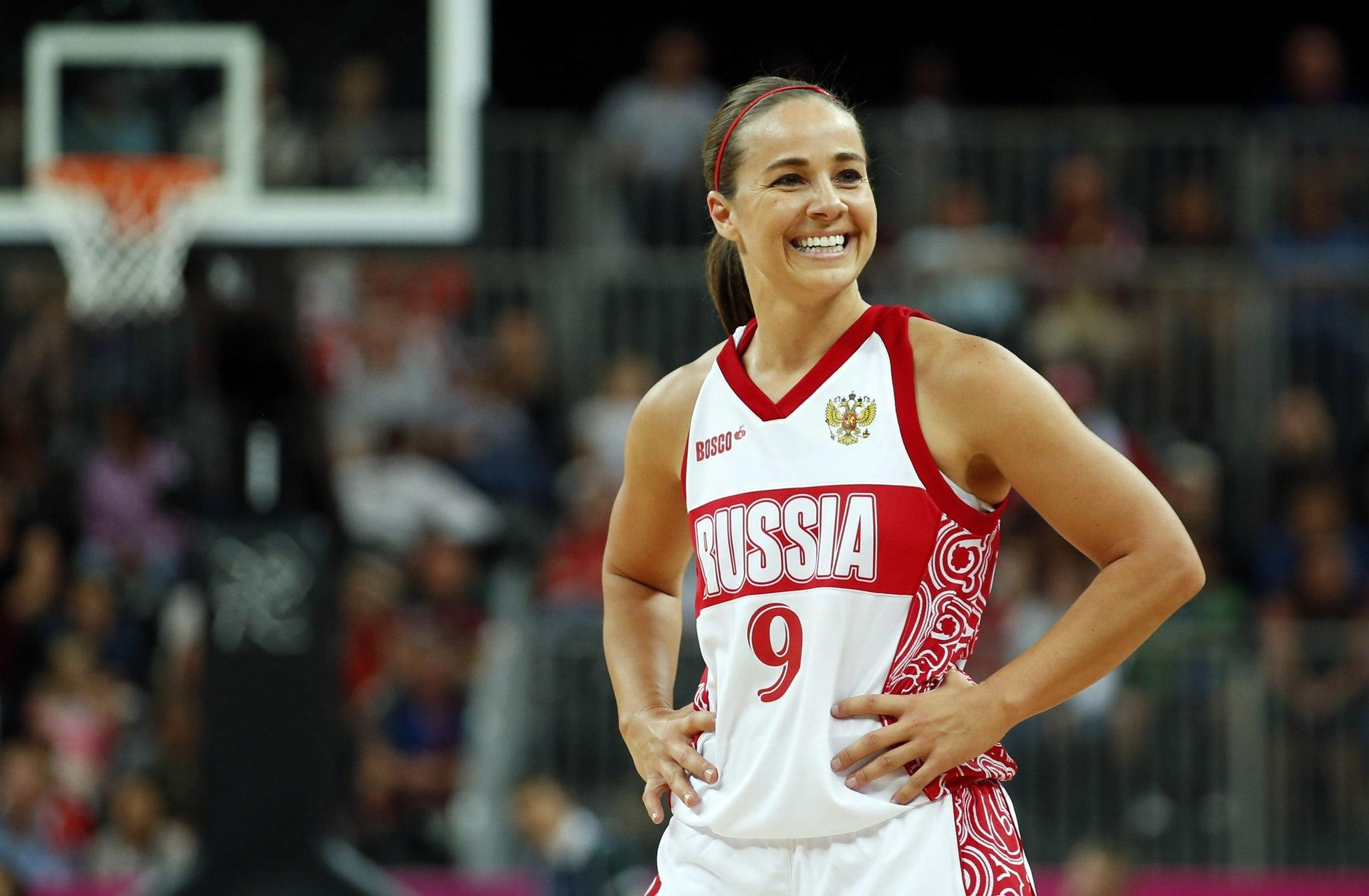 Russia's Becky Hammon smiles toward her bench during the women's preliminary round Group B basketball match against Brazil at the Basketball Arena during the London 2012 Olympic Games in this file photo taken July 30, 2012. A glass ceiling in major professional sports was cracked on August 5, 2014 when the National Basketball Association champion San Antonio Spurs named long time WNBA star Becky Hammon as the first full-time female assistant coach in NBA history.